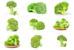 Insieme dei broccoli verdi freschi su un fondo bianco Fotografie Stock