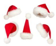 Insieme dei cappelli della Santa di natale Immagini Stock Libere da Diritti