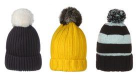 Insieme dei cappelli di inverno con il fiocchetto Fotografia Stock