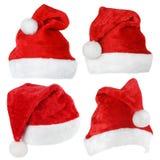 Insieme dei cappelli di rosso di Santa Claus Immagine Stock Libera da Diritti