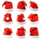 Insieme dei cappelli rossi del Babbo Natale Fotografia Stock Libera da Diritti