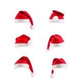 Insieme dei cappelli rossi del Babbo Natale Fotografie Stock Libere da Diritti