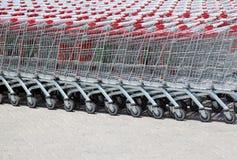 Insieme dei carrelli impilati del supermercato Fotografie Stock Libere da Diritti