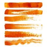 Insieme dei colpi arancio della spazzola Immagini Stock Libere da Diritti