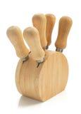 Insieme dei coltelli del formaggio su bianco Fotografia Stock