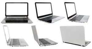 Insieme dei computer portatili con gli schermi tagliati Immagini Stock Libere da Diritti