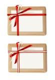 Insieme dei contenitori di regalo con l'arco del nastro e una carta Fotografie Stock Libere da Diritti