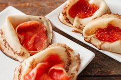 Insieme dei crêpe del dessert con frutti di mare Immagine Stock Libera da Diritti
