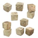 Insieme dei cubi concreti su fondo bianco. immagine stock libera da diritti