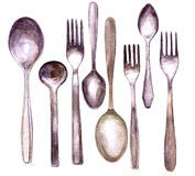 Insieme dei cucchiai e delle forchette differenti Fotografia Stock