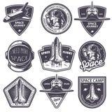 Insieme dei distintivi d'annata dell'astronauta e dello spazio illustrazione vettoriale