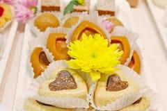Insieme dei dolci e dei biscotti Fotografia Stock