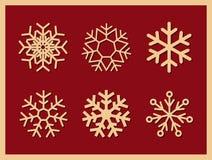 Insieme dei fiocchi di neve delle icone di vettore su fondo rosso Fotografia Stock Libera da Diritti