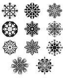 Insieme dei fiocchi di neve isolati su un fondo bianco Illustrazione di vettore Immagini Stock