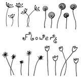 Insieme dei fiori disegnati a mano neri astratti nello stile di scarabocchio Fotografia Stock