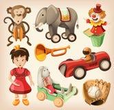 Insieme dei giocattoli d'annata variopinti per i bambini. Immagine Stock