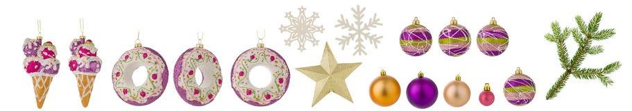 Insieme dei giocattoli di Natale isolati su fondo bianco Palle, ramo attillato, fiocchi di neve ed altri giocattoli come clipart  fotografia stock