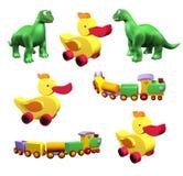 Insieme dei giocattoli variopinti dei bambini: anatra, Dino, treno isolato Immagine Stock