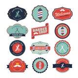 Insieme dei grafici d'annata e delle icone di logo del negozio di barbiere Fotografie Stock