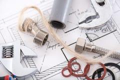 Insieme dei materiali dell'impianto idraulico Fotografie Stock