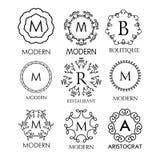Insieme dei modelli blu semplici ed eleganti del lusso, del monogramma di progettazione Fotografia Stock
