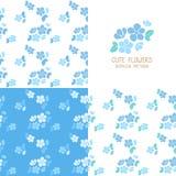 Insieme dei modelli di fiori blu senza cuciture Fotografia Stock