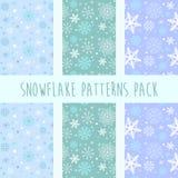 Insieme dei modelli di inverno con i fiocchi di neve Immagini Stock Libere da Diritti
