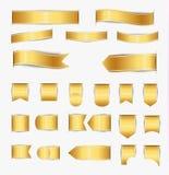 Insieme dei nastri dell'oro fotografie stock libere da diritti