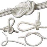 insieme dei nodi su una corda bianca, isolato su un fondo bianco Fotografia Stock