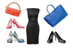 Insieme dei pattini, del vestito e dei sacchetti femminili Fotografia Stock