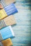 Insieme dei pennelli sul concetto di legno della costruzione del bordo Fotografia Stock