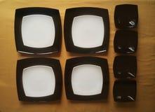 Insieme dei piatti in bianco e nero Immagini Stock