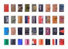 Insieme dei portafogli di cuoio multicolori isolati su fondo bianco Fotografia Stock Libera da Diritti