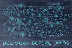 Insieme dei presente e dei fiocchi di neve di natale, con la consegna del testo prima della X Immagine Stock