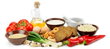 Insieme dei prodotti naturali isolati su fondo bianco Ampia foto Immagine Stock Libera da Diritti