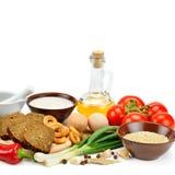 Insieme dei prodotti naturali isolati su fondo bianco Le FO in buona salute Immagini Stock Libere da Diritti