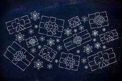 Insieme dei regali di Natale e dei fiocchi di neve conclusi Fotografie Stock Libere da Diritti