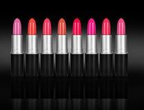 Insieme dei rossetti di colore Tavolozza del rossetto su fondo nero Immagine Stock Libera da Diritti