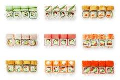 Insieme dei rotoli di sushi isolati a bianco Immagine Stock Libera da Diritti