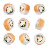 Insieme dei rotoli di sushi isolati su un fondo bianco Immagine Stock Libera da Diritti