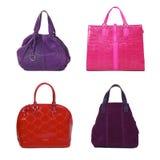 Insieme dei sacchetti femminili di colore differente Fotografia Stock