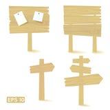 Insieme dei segni e dei tabelloni per le affissioni di legno chiari Immagini Stock