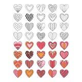 Insieme dei simboli disegnati a mano del cuore Immagine Stock