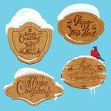 Insieme dei telai di legno con neve e testo calligrafico scritto a mano Immagine Stock