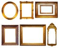 Insieme dei telai dorati. Isolato sopra fondo bianco immagine stock
