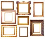 Insieme dei telai dorati Isolato sopra fondo bianco immagini stock libere da diritti