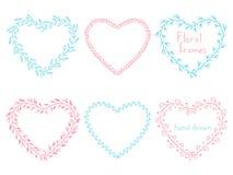 Insieme dei telai floreali sotto forma di un cuore Immagine Stock