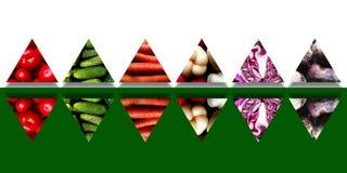 Insieme dei triangoli rispecchiati in pieno degli ortaggi freschi Fotografia Stock
