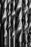 Insieme dei trivelli Fondo per industria e produzione Il modello dei trapani del metallo fotografia stock libera da diritti