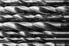 Insieme dei trivelli Fondo per industria e produzione Il modello dei trapani del metallo fotografia stock